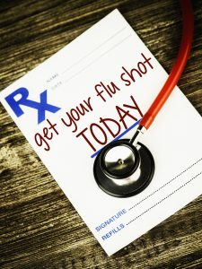 Prescription form with reminder to get flu shot today